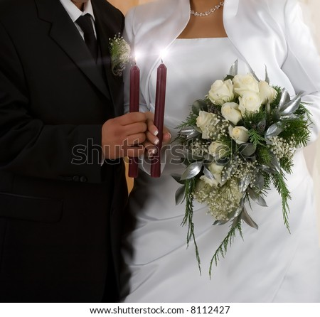 Bride and groom during ceremony - stock photo