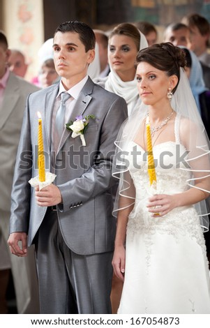 Bride and groom getting married in orthodox church - stock photo