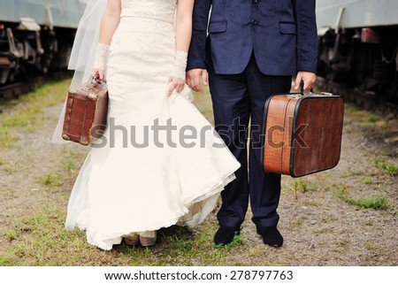bride and groom going to honeymoon - stock photo