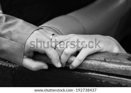 Bride and groom hands, back and white image - stock photo