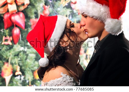bride and groom happy kissing christmas young - stock photo