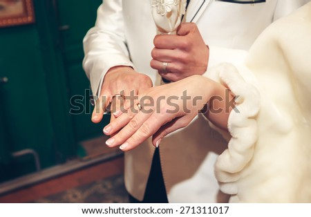 Bride and groom holding each others hands - stock photo