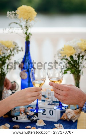 bride and groom holding their flutes with champagne - stock photo