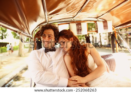 Bride and groom in a car in Paris, France - stock photo
