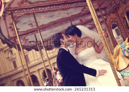 Bride and groom in a carriage - stock photo