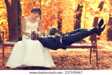 bride and groom in autumn park Love Life - stock photo