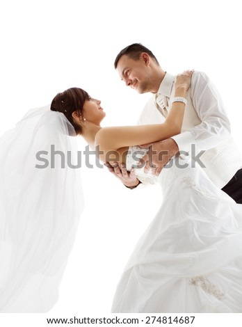 Bride and Groom in Dance, Wedding Couple Dancing, Looking Each Other Face, over White Background - stock photo