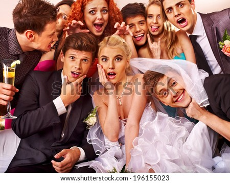 Bride and groom in photobooth. Wedding. - stock photo