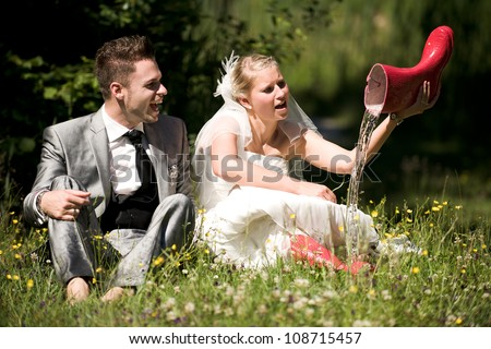 bride and groom in the nature trash the dress - stock photo