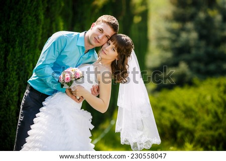Bride and groom in the park  - stock photo