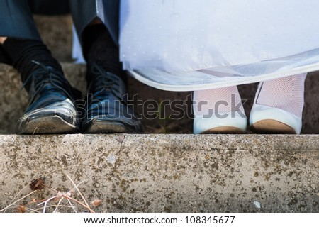 bride and groom in used wedding shoes. rest couple. close-up wedding shoes - stock photo