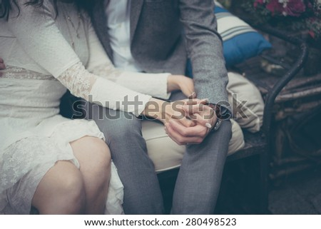 Bride and groom in vintage pastel colors - stock photo