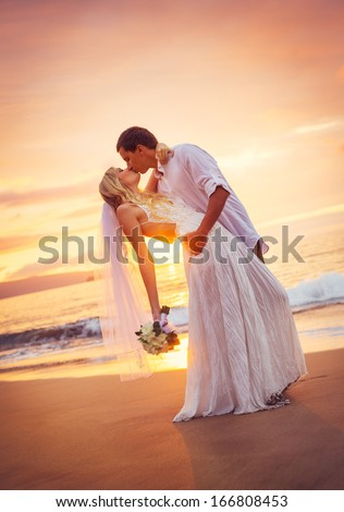 Bride and Groom, Kissing at Sunset on a Beautiful Tropical Beach, Romantic Married Couple - stock photo