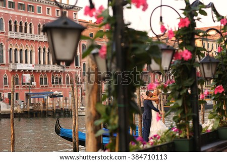 bride and groom kissing in the docks - stock photo