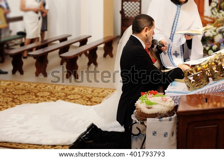 Bride and groom leaving the church during  wedding ceremony - stock photo
