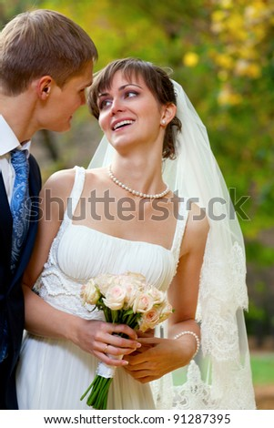 Bride and groom looking to each other - outdoor - stock photo