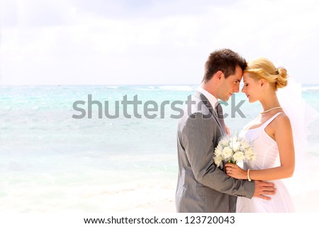 Bride and groom on a romantic moment - stock photo