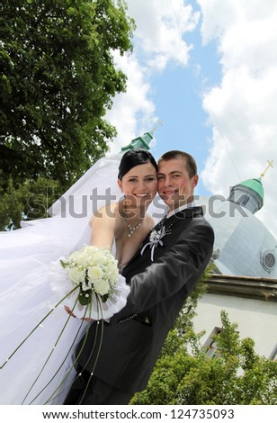 bride and groom on a walk in the park - stock photo