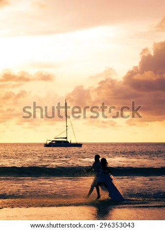 Bride and groom on the beach in Phuket - stock photo