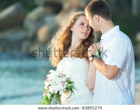 Bride and groom on the beach. Tropical wedding - stock photo