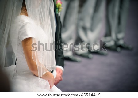 Bride and groom praying - stock photo