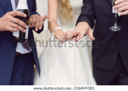 bride and groom showing their wedding rings - stock photo