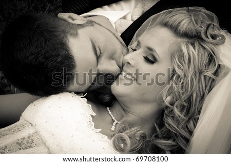 Bride and groom together after the wedding - stock photo