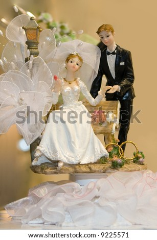 Bride and Groom Wedding Cake Ornament - stock photo