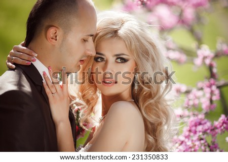 Bride and groom wedding loving couple. Kissing man and woman. Happy newlywed family dancing in green park. Bridal wedding couple Marriage. happy family, series. soft selective focus and sunset  - stock photo
