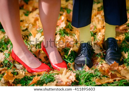 bride and groom wedding red shoes and black boots close-up - stock photo