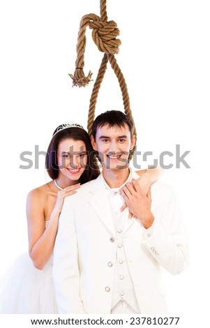 Bride and groom with a hanging rope - stock photo