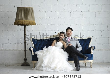 Bride and Groom with a vintage white room   - stock photo