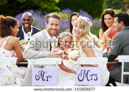 Bride And Groom With Bridesmaid At Wedding Reception - stock photo