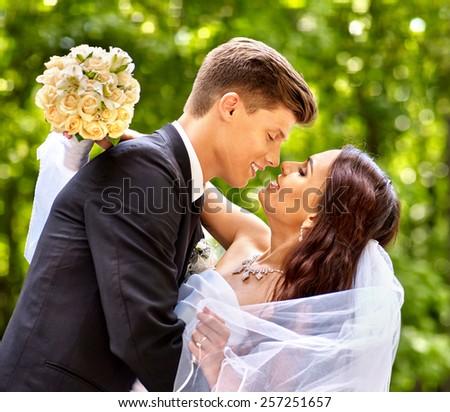 Bride and groom with flower summer  outdoor. Wedding outdoor. - stock photo