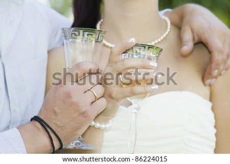 Bride and groom with glasses of champagne - stock photo