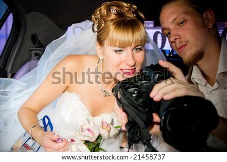 bride and photographer - stock photo