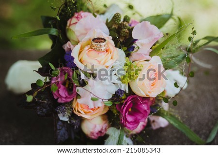 bride bouquet wedding flowers ring  - stock photo