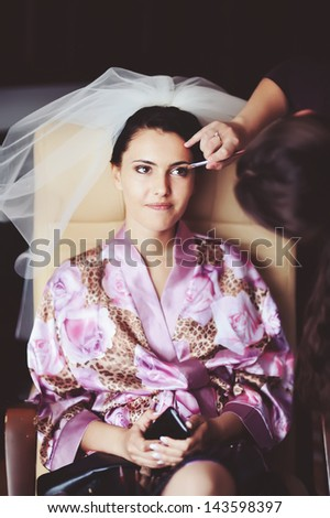 bride having a make up in the morning - stock photo