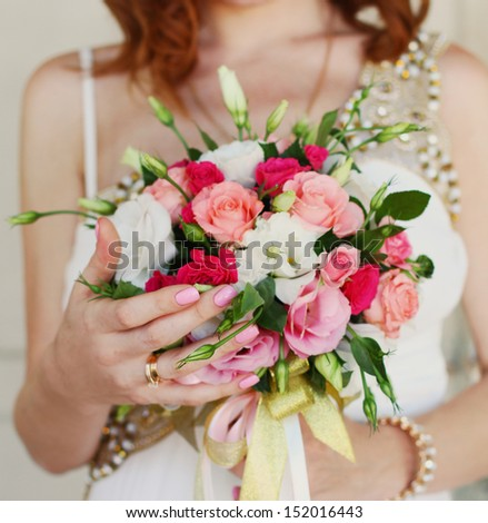 Bride holding a wedding bouquet close up - stock photo
