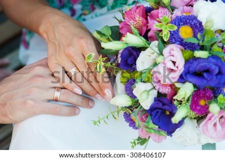 Bride holding beautiful wedding bouquet. - stock photo