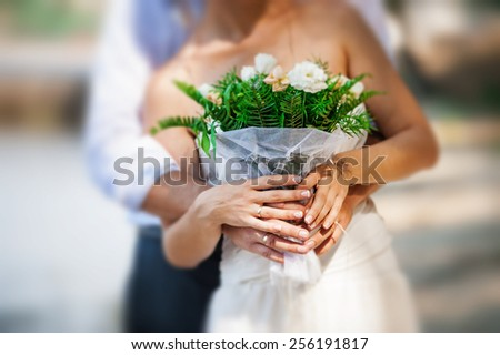 Bride holding flowers - stock photo