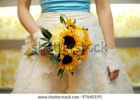 Bride holding wedding bouquet in hands - stock photo