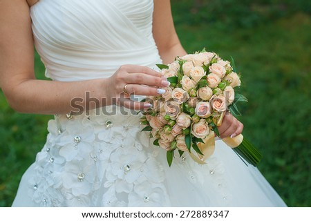 bride holds a beautiful wedding bouquet. - stock photo