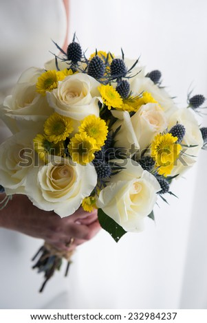 Bride holds beautiful bridal bouquet for wedding - stock photo