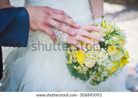 Bride holds wedding bouquet - stock photo