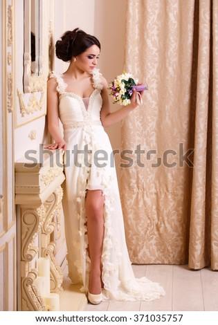 Bride in doubts, indoor shot  - stock photo