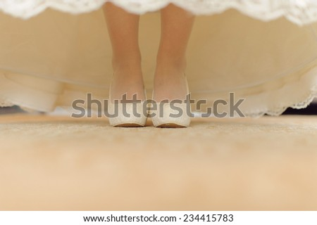 bride in elegant wedding shoes - stock photo