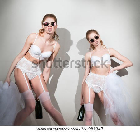 Bride in lingerie, with a bottle of champagne  - stock photo