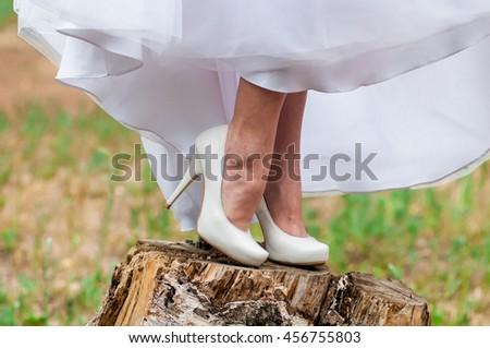 Bride in sandals - stock photo