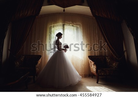 Bride in the gorgeous room in the wedding day - stock photo